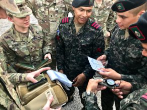 US Cadets compare battle books with Honduran military forces.