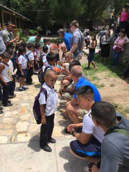 Cadets hand out treats and toys to the kids of Escuela Juan Ramon Cueva de Primera in Copan.