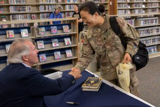 Lt. Col. Grace Kim meets author Jack Ford during book signing.