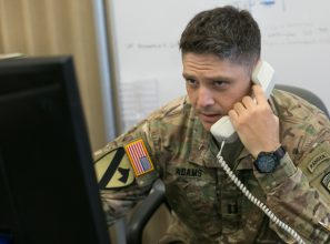 Soldier talking on phone.