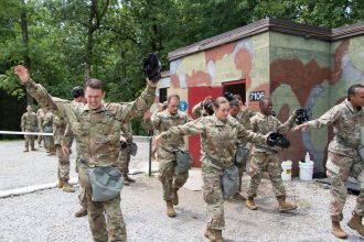 Cadets leaving the CBRN chamber flapping their arms.