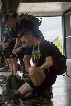Cadet Jameson Nevitt unpacks his bag of supplies.