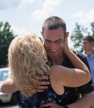 Cadet hugs a family member during Family Day.
