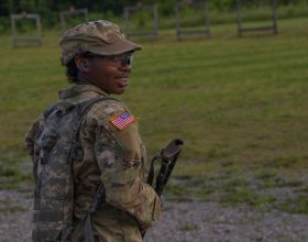 A Cadet shoots a smile over to her Cadre