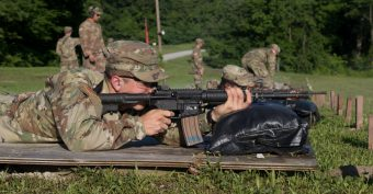 A Cadet's bullet casing flies parallel over his weapon