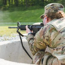 A cadet takes aim while sitting in the pit, waiting for her next target to pop up.