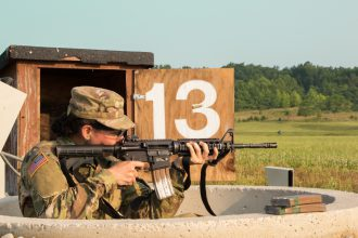 A Cadet shoots down range from the pit.