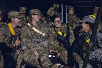 Cadets laugh together after their land navigation test.