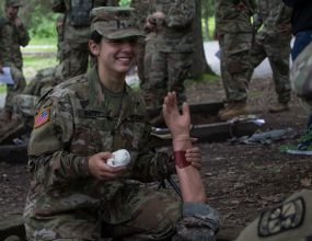 Cadet Anna Dinovo grabs a mannequin's arm during First Aid Training.