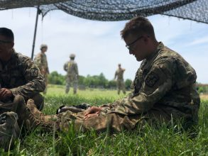 Cadet rests during the Grenade Assault Course.