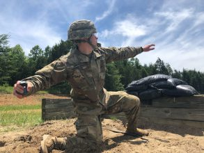 Cadet throwing a grenade.