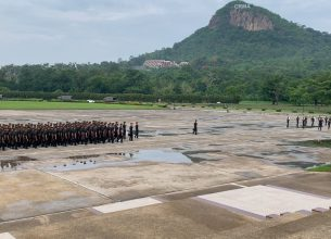 Thailand military marches with a mountain in the background.