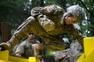 Cadet moves through the obstacle at FRLC.