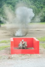 A live grenade explodes after being thrown by a cadet.