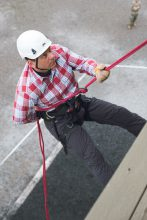 A COI rappels down the wall side of the Rappel Tower.