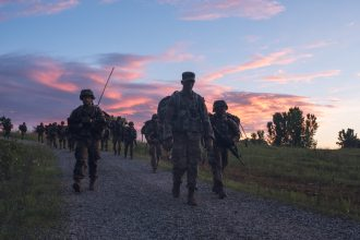 Cadets see a beautiful morning sky as they finish up their road march.