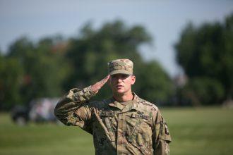 Cadet salutes General.