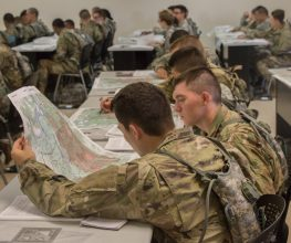 Cadets look at a map.