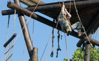 A Cadet swings on a rope.