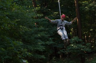 A Cadet swings on the zip line.