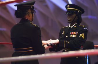 The honor guard folds the flag.