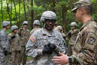 Cadet listens to instructions from a Cadre