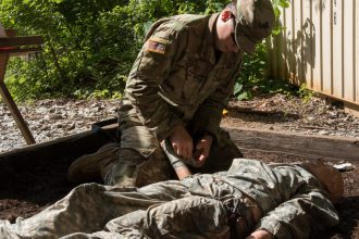 A Cadet practices applying first aid.