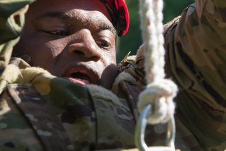 A Cadet dangles from his rope.