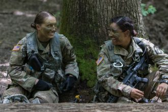 Two Cadets hang out and relax together after an ambush.