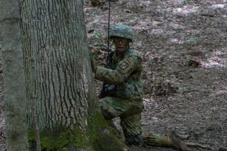 A Cadet calls out orders to his platoon.