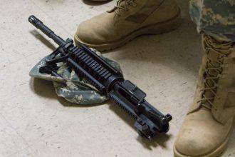 A dismantled weapon lies atop a Cadet's PC.