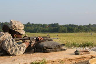 A Cadet aims down range.