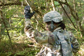 A Cadet signals her squad.