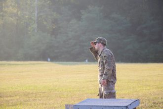 A Cadet looks out onto the range.
