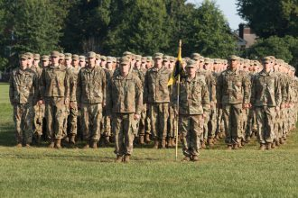 Cadets stand in formation.