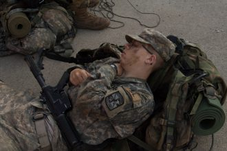 A Cadet naps after his long march.