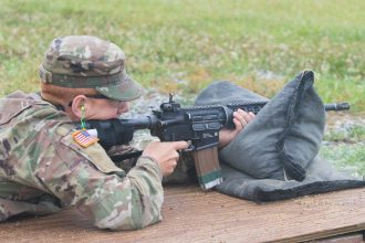 A Cadet aims his weapon.