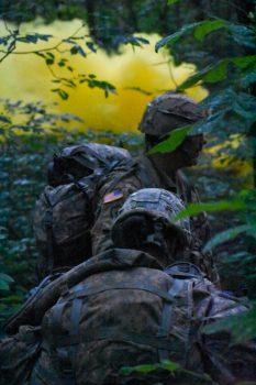 Smoke billows behind moving Cadets.