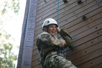 Cadet Adrian Lopez, Marion Military Institute, from 3rd Regiment, Basic Camp climbs the rock wall during the High Ropes Confidence Course at Fort Knox, Ky., July 9, 2019. | Photo by Dustin Massengill, CST Public Affairs Office