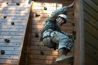 Cadet Dorian Downes, University of Texas at San Antonio, from 3rd Regiment, Basic Camp climbs the rock wall at the High Ropes Confidence Course at Fort Knox, Ky., July 9, 2019. | Photo by Dustin Massengill, CST Public Affairs Office