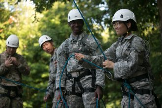 Cadet Allison Braden, University of Texas at San Antonio, from 3rd Regiment, Basic Camp belays during the High Ropes Confidence Course at Fort Knox, Ky., July 9, 2019. | Photo by Dustin Massengill, CST Public Affairs Office